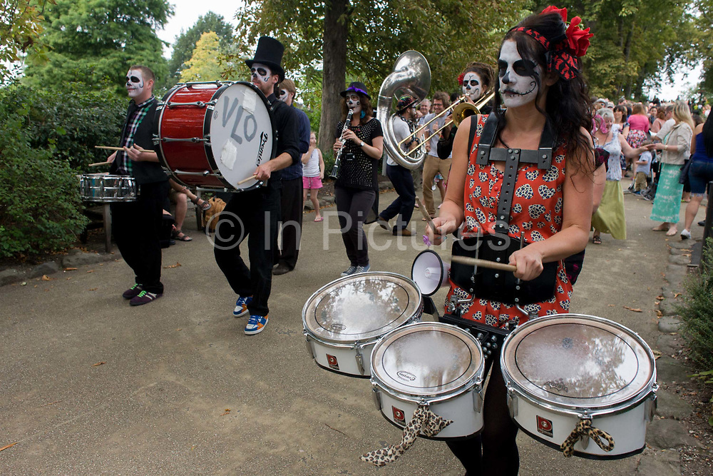 Members of the Voodoo Love Orchestra (VLO) perform to families of all ages during the Latin Music Festival at the Horniman Museum in south London. VLO play street music inspired by Cuban comparsa, Nigerian afrobeat and Jamaican ska. As the crowd behind follow the musicians who bang drums and blow their brass instruments and play and parade around Horniman Park, followed by Londoners and expat Latin speakers.