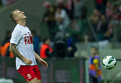 Poland's Kamil Grosicki (nr21) reacts after lost ball during the 2014 World Cup Qualifying Group H football match between Poland and England at National Stadium in Warsaw on October 17, 2012...Poland, Warsaw, October 17, 2012..Picture also available in RAW (NEF) or TIFF format on special request...For editorial use only. Any commercial or promotional use requires permission...Photo by © Adam Nurkiewicz / Mediasport