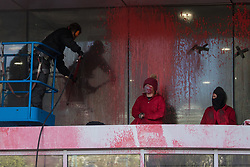 Sandwich, UK. 4th October, 2021. A man uses a cherry picker and pressure hose to wash red paint from Discovery Park House after it was occupied and sprayed by Palestine Action activists in protest against the presence in Discovery Park of an Instro Precision factory. Instro Precision is a subsidiary of Elbit Systems, Israel's largest publicly-traded arms company which markets drones used extensively by the Israeli military in Gaza as 'battle-proven', and it supplies 'high precision military equipment'. Palestine Action contends that equipment sold by Instro Precision has been used by the Israeli military against the civilian population of Gaza.