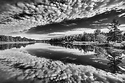 Cloud reflection on Riviere Fraser<br />Latulipe<br />Quebec<br />Canada