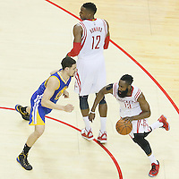 23 May 2015: Houston Rockets guard James Harden (13) drives past Golden State Warriors guard Klay Thompson (11) on a screen set by Houston Rockets center Dwight Howard (12) during the Golden State Warriors 115-80 victory over the Houston Rockets, in game 3 of the Western Conference finals, at the Toyota Center, Houston, Texas, USA.
