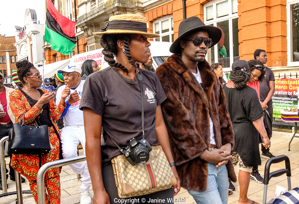 People at Reparations Rebellion event on Afrikan Emancipation Day in Windrush Square, Brixton 2021.