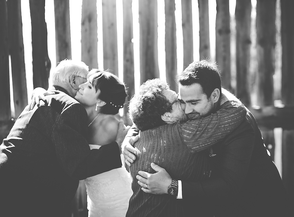 Wedding Photos by Connie Roberts Photography<br /> Bride and Groom hug grooms parents after the ceremony