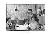 Family bath night in Ballyfermot, County Dublin.<br /> <br /> 12th October 1958<br /> 12/10/1958