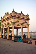 Two women sit by the Pier on the Stand in Chandannagar, India