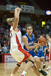 04 February 2006: Holly Hallstrom impedes the path of Stephanie Lisch. The Indiana State Sycamores shook the Illinois State Redbirds from the nest with a 75-71 Victory.  There were 3,581 fans on hand, making the audience the  2nd largest women's basketball crowd ever in Redbird Arena on Illinois State University campus in Normal Illinois.