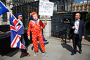 Anti Brexit protester in Westminster dressed up as a clown Boris Johnson, tells passers by his policies which are all about Me, as inside Parliament the Tory leadership race continues on 17th June 2019 in London, England, United Kingdom.