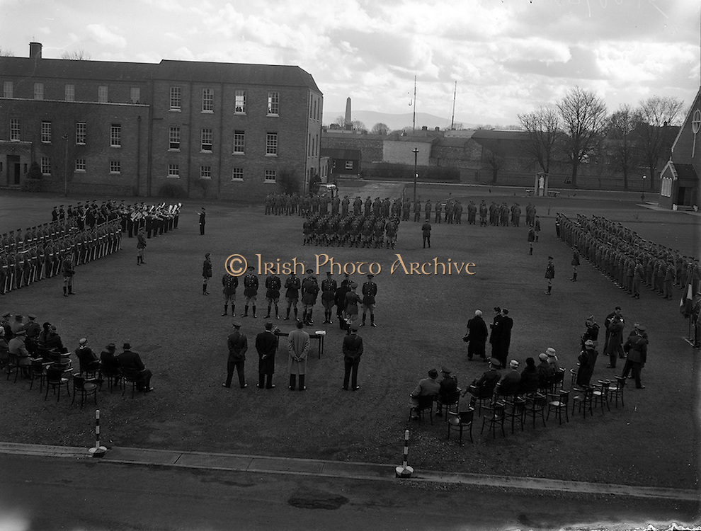 11/04/1960<br /> 04/11/1960<br /> 11 April 1960<br /> The United Nations Medal was presented to 47 Officers of the Irish Army who served in U.N.O. forces in 1959/60,by the Taoiseach Sean Lemass at a ceremony at Collin's Barracks, Dublin. <br /> Picture shows:a general view of the ceremony as the Taoiseach Sean Lemass pins the medal on Captain Edmond Russell of Southern Command (second from right in row of officers in foreground).