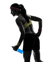 one woman exercising fitness holding energy drink in silhouette on white background