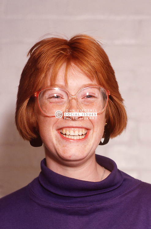 Portrait of teenage girl wearing glasses smiling,