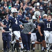 NEW HAVEN, CONNECTICUT - NOVEMBER 18: Darrion Carrington #4 of Yale and Caden Herring #11 of Yale celebrate the teams win at the end of the game during the Yale V Harvard, Ivy League Football match at the Yale Bowl. Yale won the game 24-3 to win their first outright league title since 1980. The game was the 134th meeting between Harvard and Yale, a historic rivalry that dates back to 1875. New Haven, Connecticut. 18th November 2017. (Photo by Tim Clayton/Corbis via Getty Images)