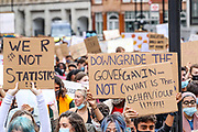 Students shouting and holding banners and placards march towards Downing Street, Whitehall in central London from the Department for Education on Sunday, Aug 16, 2020. Students are reacting to the downgrading of A-Level results as a result of the Covid-19 pandemic. <br /> Thousands of pupils across England have expressed their disappointment at having their results downgraded after exams were cancelled due to coronavirus. A-levels results that were announced on 13 August. Some 40 per cent of students across England have received downgraded results. (VXP Photo/ Vudi Xhymshiti)