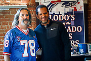 SHOT 12/10/17 12:30:44 PM - Former Buffalo Bills wide receiver and Hall of Fame player Andre Reed signs autographs and meets with fans at LoDo's Bar and Grill in Denver, Co. as the Buffalo Bills played the Indianapolis Colts that Sunday. Reed played wide receiver in the National Football League for 16 seasons, 15 with the Buffalo Bills and one with the Washington Redskins. (Photo by Marc Piscotty / © 2017)