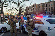 Washington DC, USA - January 19, 2021: Members of the Pennyslvania National Guard man a vehicle checkpoint at Massachusettes and Second Street NE on the eve of President-elect Biden's inauguration.