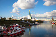 Rhine harbor Deutz, view to the Severins bridge and the cathedral,  fire-fighting boats, Cologne, Germany.<br /> <br /> Deutzer Hafen, Blick zur Severinsbruecke und zum Dom, Feuerloeschboote, Koeln, Deutschland.