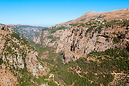 The historic and narrow Qadisha Valley in Lebanon. It is home to a large Christian population and several churches and monasteries. One church is visible on the mountain slope in the upper right.