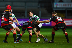 Newcastle Falcons' Adam Radwan is tackled by Dragons' Elliot Dee<br /> <br /> Photographer Craig Thomas/Replay Images<br /> <br /> EPCR Champions Cup Round 4 - Newport Gwent Dragons v Newcastle Falcons - Friday 15th December 2017 - Rodney Parade - Newport<br /> <br /> World Copyright © 2017 Replay Images. All rights reserved. info@replayimages.co.uk - www.replayimages.co.uk
