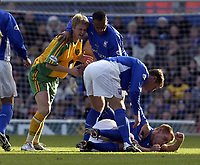 Picture: Henry Browne.<br />Date: 21/12/2003.<br />Iswich Town v Norwich City Nationwide First Division.<br />Matt Svennson of Norwich is pulled off after his foul on Ipswich's Richard Naylor.