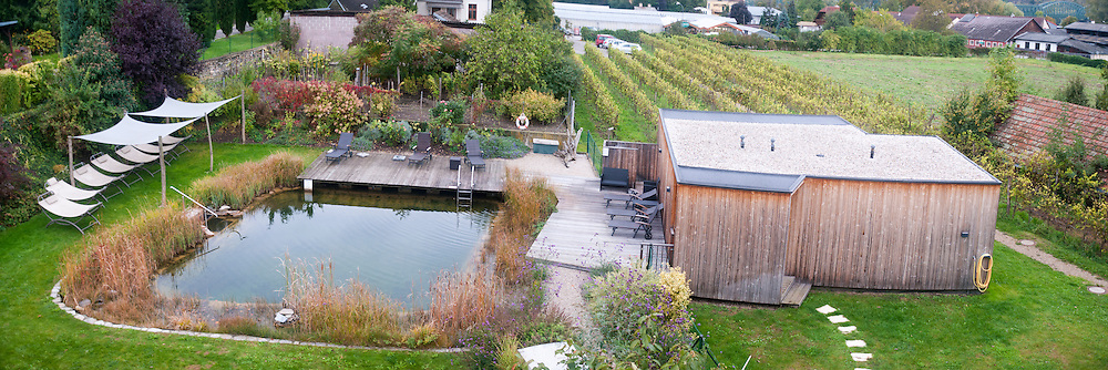 Ecological swimming pool and sauna complex. Plants are used to keep the water clean Photographed in Austria