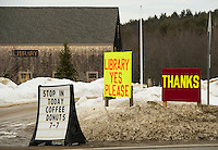 """Signs for """"support and thanks"""" for the Gilmanton Library on election day with the polls open at Gilmanton Elementary School on Tuesday afternoon.  (Karen Bobotas/for the Laconia Daily Sun)"""