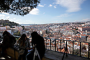 View from Graça belvedere to the Baixa district and the hill with Castelo de S. Jorge at the left.This is part of the way of Lisbon's nº28 yellow tram, through the central, most historic region of the city.