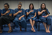 Women pray before being baptised during a ceremony at Lakewood Church in Houston, Texas, U.S., April 28, 2018.