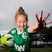 27.07.17.          <br /> Ireland Women's Rugby captain Niamh Briggs was mobbed by young fans in Limerick earlier today (Thursday) as she arrived in the city by boat for the Women's Rugby World Cup trophy tour.<br /> <br /> Ireland Women's Rugby Team coach Tom Tierney might not need to look further than home for new talent in the future as his daughter Isabel Tierney, 7 shows her support  for the team during the event.<br />  <br /> The Limerick based garda and Munster fullback was escorted on the River Shannon by Limerick Marine Search and Rescue along with Nevsail kayakers as she made her way to Arthur's Quay jetty to be officially met by Mayor of Limerick, Cllr Stephen Keary. Picture: Alan Place