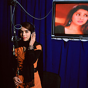 "Madoon Ghaffur, 22, is single and works as a singer and actress in the dubbing studio at Ariana Television.  Ariana has an ambitious broadcasting schedule showing several Indian dramas which are contrary to conservative popular opinion.  Despite concerns from Parliament  - which has banned the airing of soaps -  and threats of violence from the Taliban, the company and its main rival Tolo TV, are aggressive in their airing of shows all of which have massive public appeal. <br /> <br /> <br /> Currently, Madoon is translating the Indian soap ""Zaara"" into the local Afghan language Dari. She also dubs ""Dolhan"" an Indian soap and is a well-known singer. Madoon is a success story in the new Kabul enjoying a freedom that was quashed under the Taliban and impossible during the civil war:  ""During Taliban I couldn't go anywhere, I had to stay at home , I felt imprisoned, but now I am free."
