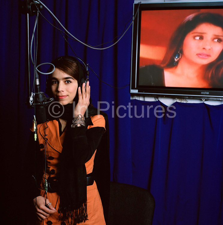 """Madoon Ghaffur, 22, is single and works as a singer and actress in the dubbing studio at Ariana Television.  Ariana has an ambitious broadcasting schedule showing several Indian dramas which are contrary to conservative popular opinion.  Despite concerns from Parliament  - which has banned the airing of soaps -  and threats of violence from the Taliban, the company and its main rival Tolo TV, are aggressive in their airing of shows all of which have massive public appeal. <br /> <br /> <br /> Currently, Madoon is translating the Indian soap """"Zaara"""" into the local Afghan language Dari. She also dubs """"Dolhan"""" an Indian soap and is a well-known singer. Madoon is a success story in the new Kabul enjoying a freedom that was quashed under the Taliban and impossible during the civil war:  """"During Taliban I couldn't go anywhere, I had to stay at home , I felt imprisoned, but now I am free."""