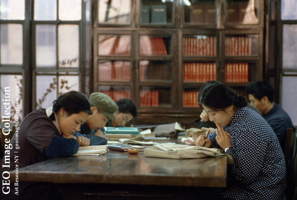 Young students studying at the Beijing University Library.