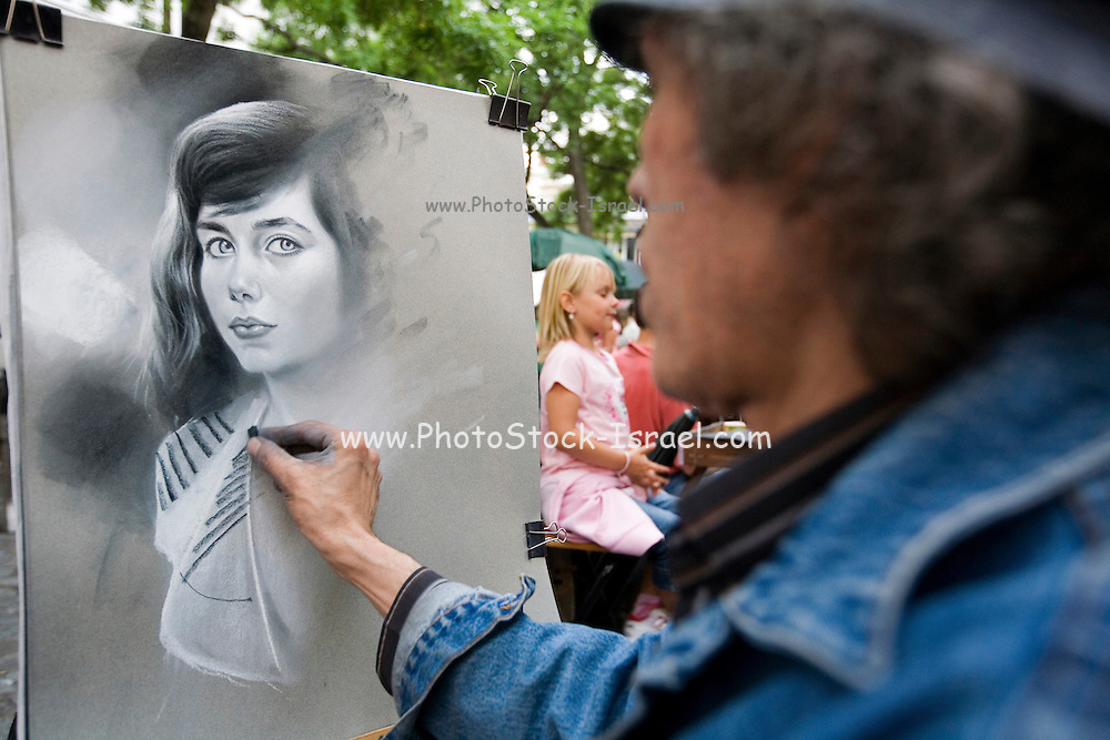 street Artist at work drawing a portrait of a customer