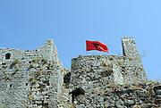 The Albanian flag flies above the ruins of Rozafa castle, Kalaja e Rozafës. Shkodër, Albania. 02Sep15