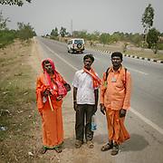Hindu Pilgrims walking to a shrine along the highway near Bangalore, Karnataka province.