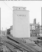 "Ackroyd 07126-1 ""Leval Mickelson. Cargill Grain elevators. September 10, 1956"" (Balfour, Guthrie & Co., Bunge Grain, Permanente Cement dock, Cargill Irving grain elevator, ECSI # 5561, 800 N. River St.)"