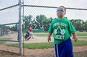 Young Down's Syndrome boy wearing his This Guy is Lucky Irish t-shirt at the ball game. St Paul Minnesota MN USA