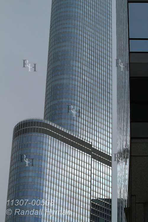 Glass facade of Trump International Hotel and Tower looms amid storm clouds, Chicago, Illinois.