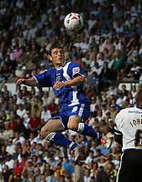Photo: Paul Thomas.<br /> Derby County v Cardiff City. Coca Cola Championship.<br /> 20/08/2005.<br /> <br /> Jason Koumas wins a header.