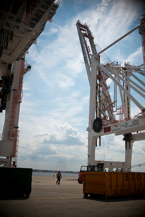 (photo by Matt Roth).Wednesday, July 11, 2012.Assignment ID: 30128574A..Local 16 union iron worker Matt Kardczyk is dwarfed by the super-post Panamax cranes -- the largest model built -- which he is helping to erect at The Port of Baltimore's Seagirt Marine Terminal Wednesday, July 11, 2012. ..Once the building, testing and training is finished, the Seagirt terminal will join Norfolk, VA as one of the only two ports on the East Coast which can unload new Panamax sized container ships. The cranes are expected to be fully operational in September of this year.