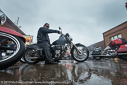 A very wet downtown Sturgis during the annual Black Hills Motorcycle Rally. SD, USA. August 5, 2014.  Photography ©2014 Michael Lichter.