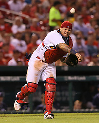 August 22, 2017 - St Louis, MO, USA - St. Louis Cardinals catcher Yadier Molina throws out the San Diego Padres' Carlos Asuaje on a sacrifice bunt in the fifth inning on Tuesday, Aug. 22, 2017, at Busch Stadium in St. Louis. The Padres won, 12-4. (Credit Image: © Chris Lee/TNS via ZUMA Wire)