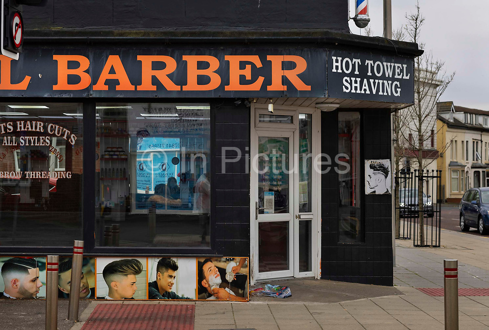 Turkish traditional barbers on 21st April 2021 in Blackpool, Lancashire, United Kingdom. Blackpool is a large town and seaside resort in the county of Lancashire on the north west coast of England. Blackpool was once a booming resort with it's famous promenade which now, despite having a somewhat shabby appearance, still continues to attract millions of visitors each year. During the coronavirus pandemic however, Blackpool has struggled, with empty streets and closed down businesses creating an atmosphere more like a ghost town.