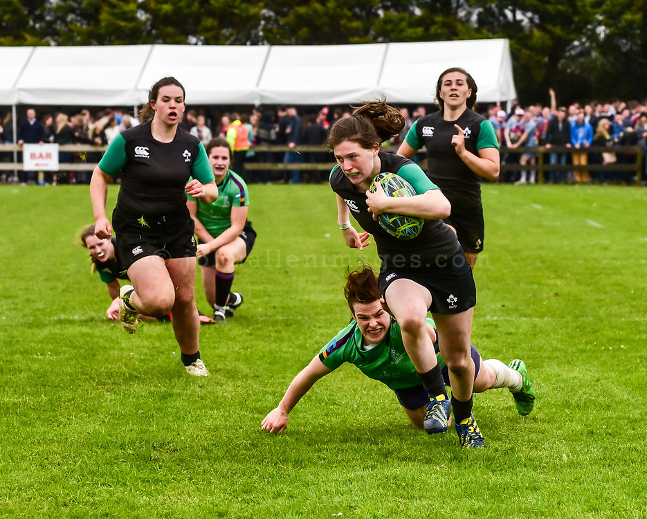 """REPRO FREE<br /> Katie Heffernan from the IRFU Development VII on her way to scoring a try in their 40-5 defeat of Railway Union to win the 2016 Hayes Caravan Services Women's Cup at the The Heineken Kinsale 7s over the May Bank Holiday weekend.<br /> Picture. John Allen<br /> <br /> *** PRESS RELEASE *** <br /> Sunday 1st May 2016<br /> <br /> 2016 HEINEKEN KINSALE 7s <br /> The Wooden Spoon Charity team from the UK were crowned 2016 Heineken Kinsale 7s Champions over Forces Exiles 19-15 in a tightly contested final. The Irish Development Women's Team won the Women's Trophy and The Lightning Bolts won the Men's Open for the fourth time in a row. <br /> Now in its 28th year, the Heineken Kinsale 7s is Ireland's largest rugby 7s tournament and builds on its success each year. Over 70 teams and supporters enjoyed great running rugby and the huge festival atmosphere in Kinsale RFC and in the town over the May Bank Holiday weekend.<br /> Men's Elite Champions<br /> Wooden Spoon Charity<br /> Forces Exiles <br /> Hayes Caravan Services Women's Cup<br /> IRFU Development VII<br /> Railway Union <br /> Men's Open Champions<br /> Lightning Bolts<br /> Lloyds RFC<br /> Men's Social<br /> Goat Nation<br /> Strictly Anal RFC<br /> Women's Social<br /> Team Boom<br /> Blackrock RFC<br /> <br /> Pat Maher, Event and Sponsorship Manager, Heineken Ireland said: """"Heineken, alongside our business partners in Kinsale and surrounding areas, are delighted to continue our long association with this fantastic event over the May Bank Holiday weekend.""""<br /> Tomás O'Brien, Tournament Director, thanked all sponsors, associate partners, club members and volunteers for their continued involvement and support. """"The Heineken Kinsale 7s generates a huge boost to Kinsale Rugby Club and the local economy and is staffed entirely by volunteers. I wish to thank Heineken, Kukri Ireland and all our partners and volunteers for their continued support. We look forward to welcoming all teams and visitors """
