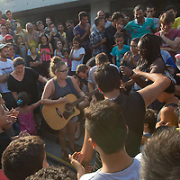 Illegal migrants enjoy music played by a volunteer in a transit zone at the main railway station Keleti in Budapest, Hungary on September 02, 2015. ATTILA VOLGYI