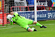 Liam Roberts of Walsall makes a save or saves during the EFL Cup match between Walsall and Sheffield Wednesday at the Banks's Stadium, Walsall, England on 5 September 2020.