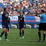 U.S. players U.S. forward Abby Wambach (20) and U.S. midfielder Carli Lloyd (10) question a call during an international friendly soccer match between the United States Women's National soccer team and the Russia National soccer team at FAU Stadium on Saturday, February 8, in Boca Raton, Florida. The U.S. won the match by a score of 7-0. (AP Photo/Alex Menendez)