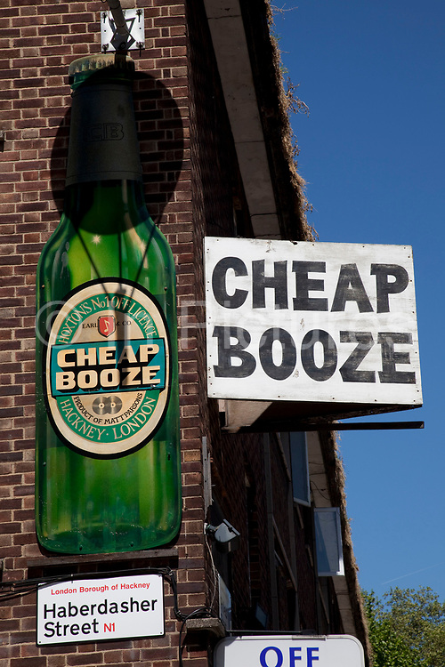 Sign for a shop selling Cheap Booze. The low cost selling of alcohol is a particularly thorny issue in the UK where alcohol abuse is rife. This shop in Hoxton in East London is well reknowned for it's rather obvious signage.