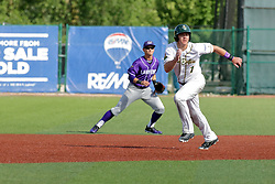 28 May 2017: Aaron Dudley heads for third base on a hit ball during a Frontier League Baseball game between the Lake Erie Crushers and the Normal CornBelters at Corn Crib Stadium on the campus of Heartland Community College in Normal Illinois