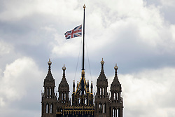 © Licensed to London News Pictures.09/04/2021. London, UK. The Union Flag flies at half mast above The Houses of Parliament following an announcement regarding the death of Prince Philip. Buckingham Palace has announced that Prince Philip The Duke of Edinburgh passed away this morning at Windsor Castle . Photo credit: George Cracknell Wright/LNP