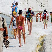 Tourist crowd on white calcium travertines at Pammukale (Pamukkale, Turkey - Jul. 2008) (Image ID: 080710-1547372a)
