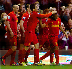 17.11.2012, Anfield, Liverpool, ENG, Premier League, FC Liverpool vs Wigan Athletic, 12. Runde, im Bild Liverpool's Luis Alberto Suarez Diaz celebrates scoring the first goal against Wigan Athletic with team-mates Jose Enrique and Raheem Sterling in action against Wigan Athletic during the English Premier League 12th round match between Liverpool FC and West Wigan Athletic at Anfield, Liverpool, Great Britain on 2012/11/17. EXPA Pictures © 2012, PhotoCredit: EXPA/ Propagandaphoto/ David Rawcliffe..***** ATTENTION - OUT OF ENG, GBR, UK *****